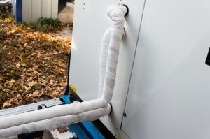 insulated-refrigerant-line-behind-air-conditioner